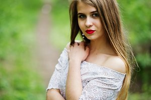 Girl in red dress in spring