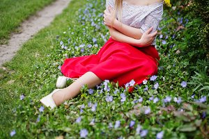 Girl in red dress in spring