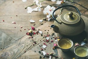 Traditional Asian tea ceremony arrangement over rustic background, copy space