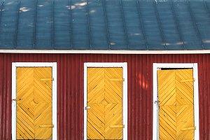 Three vintage yellow doors