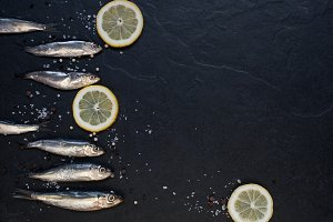 Small fishes with lemon on the table