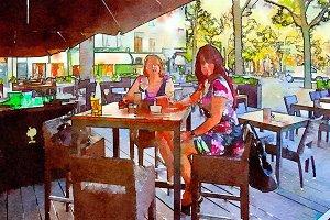 women are drinking in street cafe
