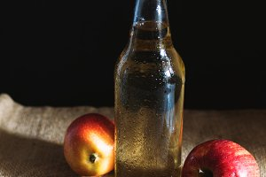 Alcoholic Apple cider in glass bottl