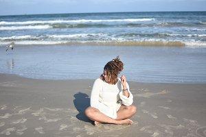 Black Woman Sitting On Beach