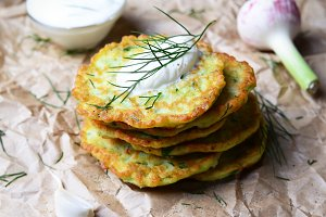Zucchini Fritters on rustic background