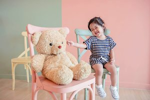 Happy Child with Teddy Bear