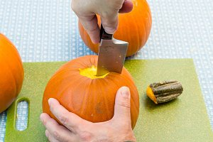 Cutting up an orange pumpkin