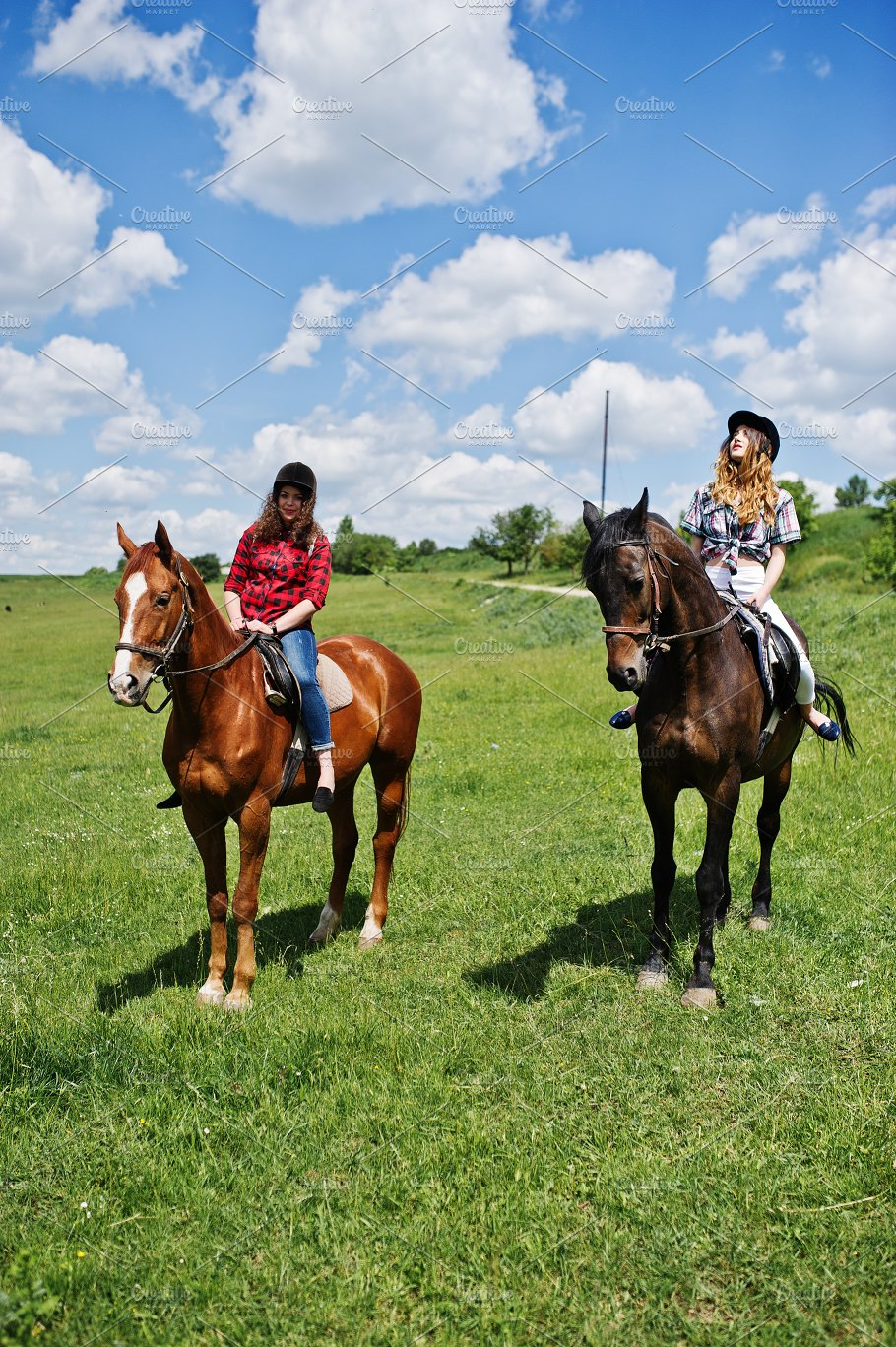 Two Girls Riding A Horses