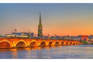 Pont de Pierre bridge and Saint Michel Basilica in Bordeaux, France