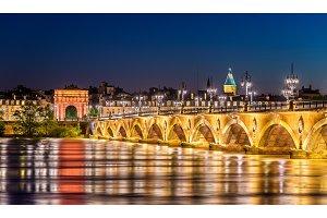 Pont de Pierre bridge and Porte de Bourgogne Gate in Bordeaux, France