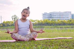 young girl's enjoy practice yoga