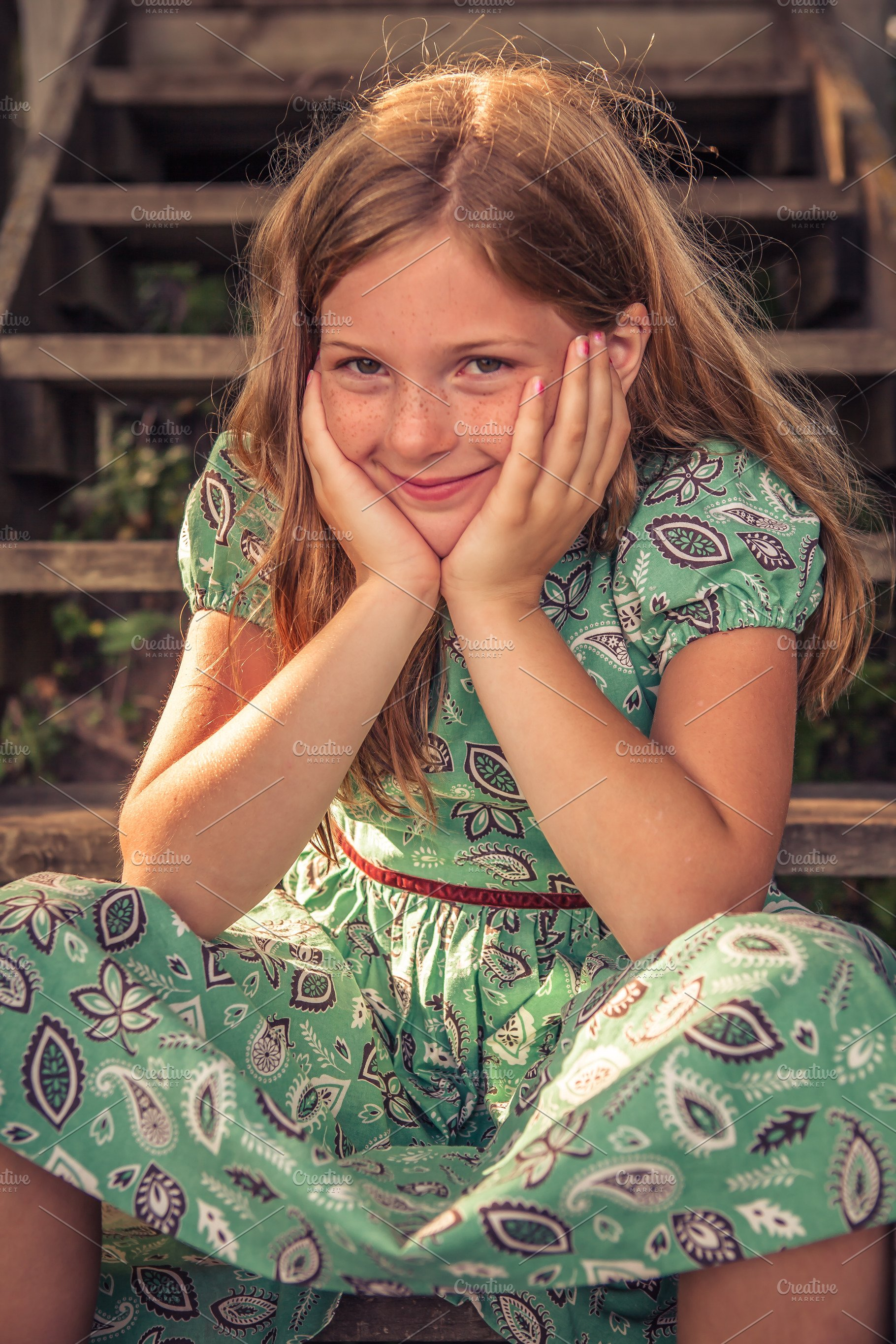 Young Girl Smiling On Wood Steps
