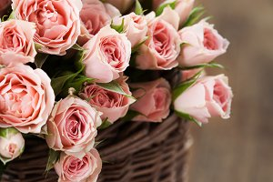 Bouquet of pink spray roses in basket