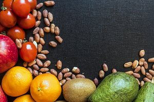 organic natural fresh superfood fruit seed and nuts on dark background copy space