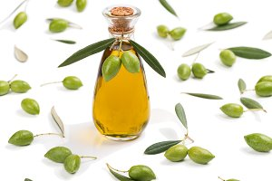 Green olives and bottle of olive oil