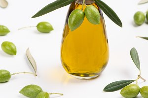Bottle of olive oil and green olives