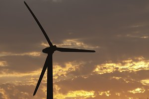Silhouetted Wind Turbine at Sunset