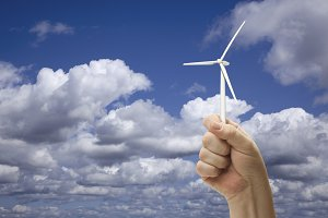 Male Fist Holding Wind Turbine Outsi