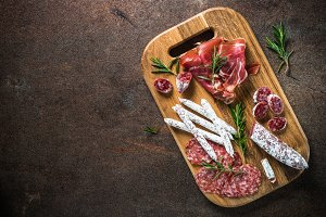 Antipasto - sliced meat, ham, salami, olives and wine  top view.