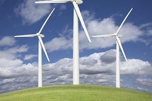 Three Wind Turbines Over Grass Field