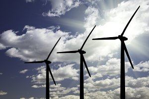 Silhouetted Wind Turbines and Clouds