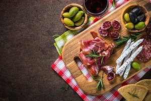 Antipasto delicatessen - sliced meat, ham, salami, cheese, olive