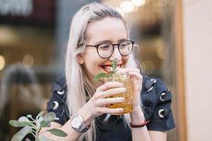 young girl having fun with soda
