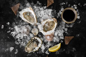 Opened oysters, dry ice and lemon