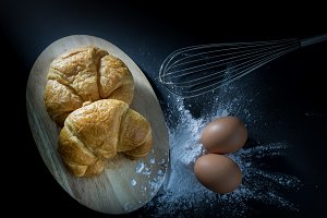 Croissant, with egg and flour.