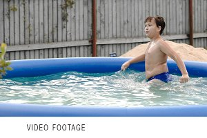 Boy swimming in inflatable pool