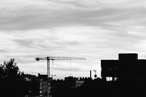 Black and white cityscape of Madrid with construction crane and