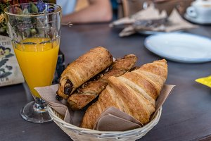 breakfast with orange juice and croissants with chocolate