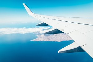 Wing of airplane above island