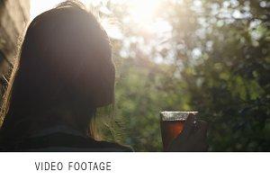 Woman having tea outdoor during