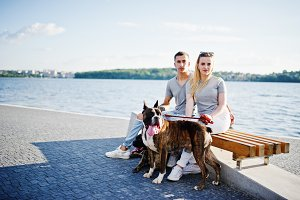 Couple and two dogs pit bull