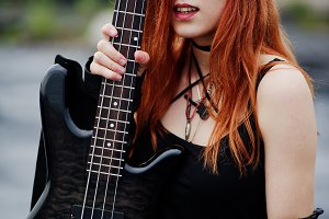 punk girl with bass guitar