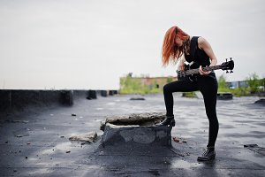 punk girl with bass guitar