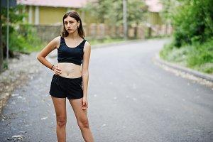 Sport girl at sportswear exercising