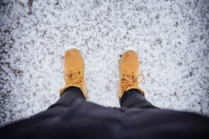 Orange boots on the snow