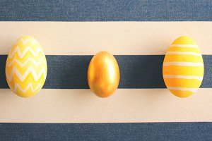 Easter eggs on striped background