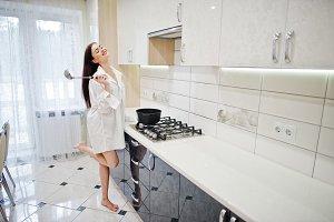 Brunette girl in the kitchen.