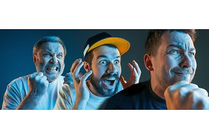 The emotional angry men screaming on blue studio background