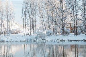 Snowy landscape reflexed in river