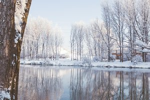 Snowy landscape by the river