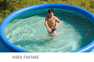 Boy having fun in outdoor pool