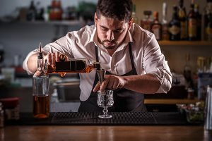 Bartender preparing alcohol cocktail