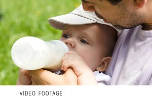 Dad feeding his baby from the bottle