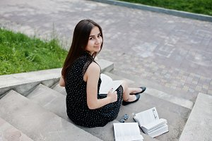 Girl student with book
