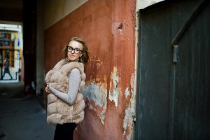 Blonde girl at fur coat