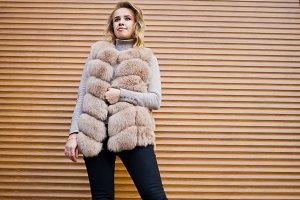 Blonde girl at fur coat